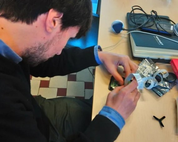 Kris Vanherle and colleague Giovanni Maccani work on the production of a sensor device which is housed inside an expensive casing made by TEKO