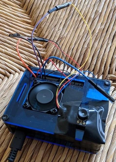 camera attached to raspberry pi in a case
