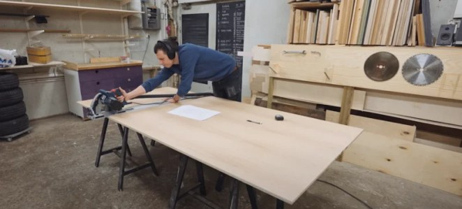 Maker cutting large piece of wood for the project