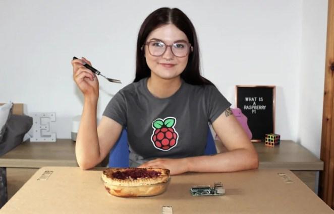 Ellora James in a Raspberry Pi t shirt eating a pie