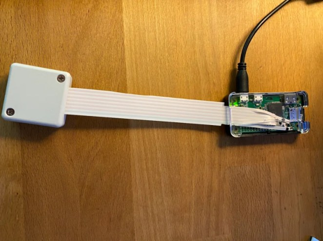 Wires from the encased sensor are soldered to Raspberry Pi Zero. The maker wants to add a door sensor, too, for speedier alerts
