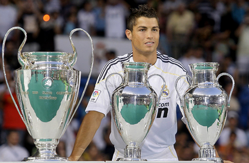 749-cristiano-ronaldo-staring-at-real-madrid-champions-league-trophies