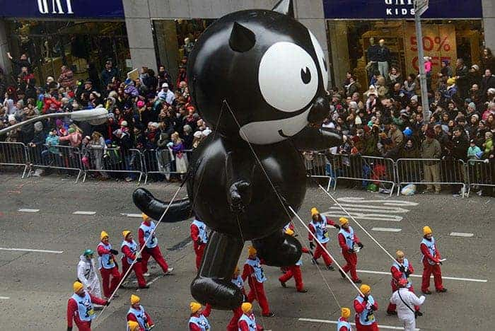 Felix cat wrangled down Broadway