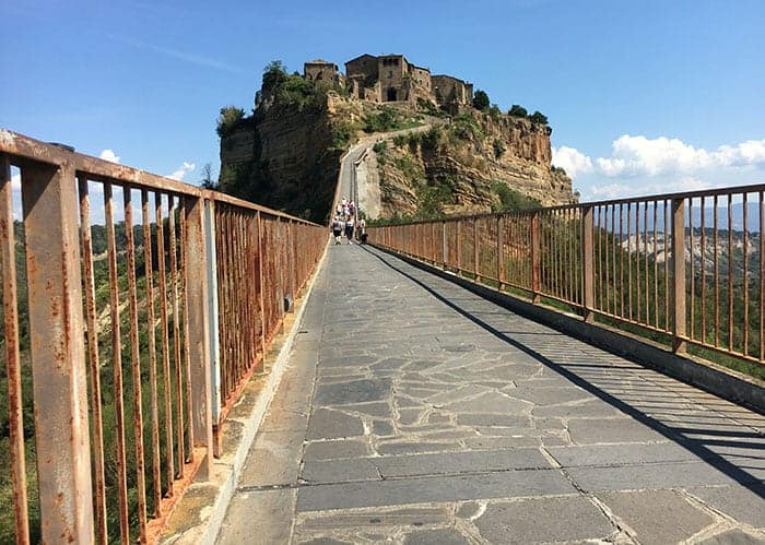 Walk to hilltop town in Italy