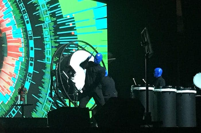 Blue Man Group performing on stage over lunch