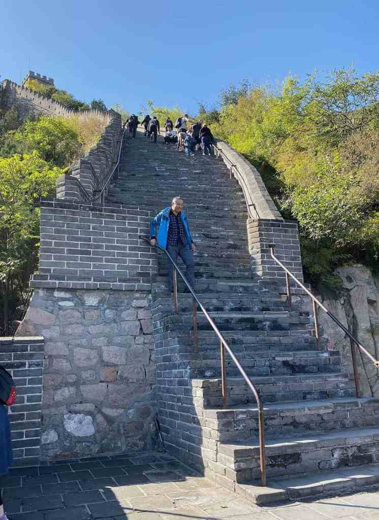 Climbing the Great Wall of China steps