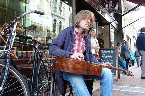 Guitar busker outside Bewleys