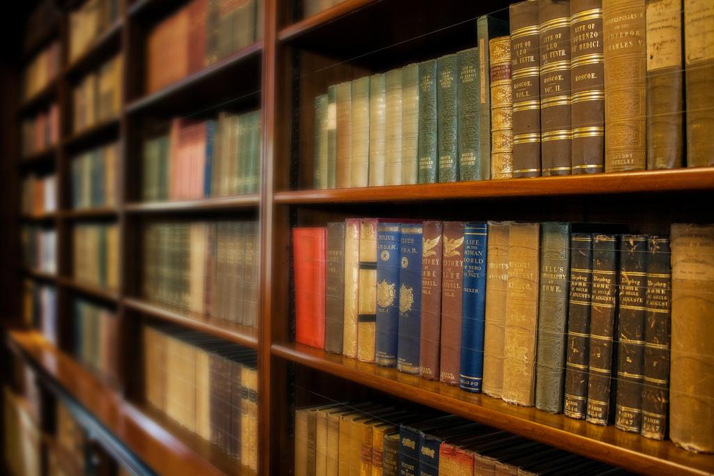 Bookshelves full of old books waiting to be read