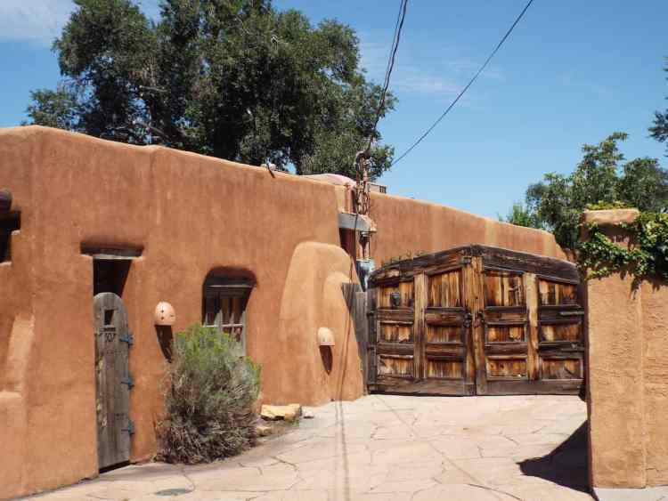 One of the oldest gates in America keeping you out of this classic Santa Fe house