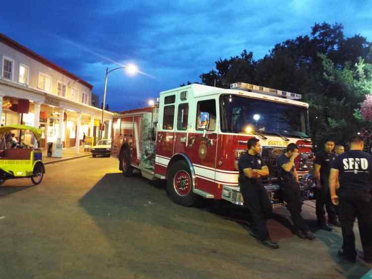 Firefighters chilling out and listening to the live music in Santa Fe