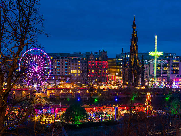 A picture of Edinburgh's Christmas market all lit up at niight.
