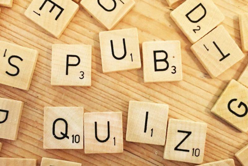 wooden scrabble pieces spelling out pub quiz