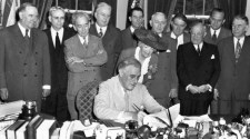 Photograph of President Roosevelt signing the GI Bill