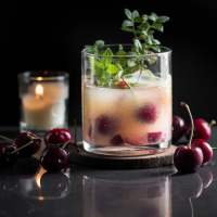 Orange Whiskey Sour with Cherries