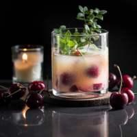 Orange Whiskey Sour with Cherries