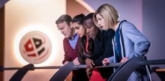 Doctor Who - Series 11 - Episode 7 - Kerblam - Graham (BRADLEY WALSH), Yaz (MANDIP GILL), Ryan (TOSIN COLE), The Doctor (JODIE WHITTAKER) at Kerblam! Headquarters.
