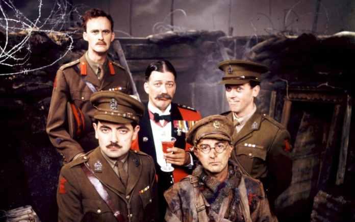 Stephen Fry as General Melchett, alongside the rest of the cast of Blackadder Goes Forth (c) BBC Studios