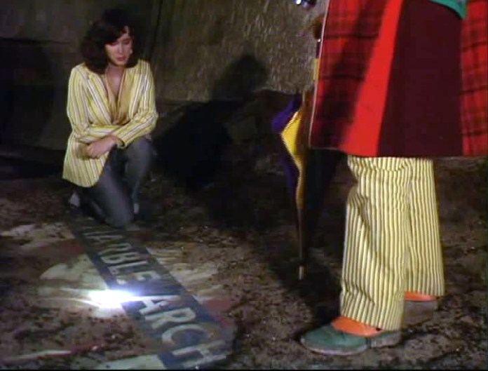 "The Doctor and his companion find an underground sign that reveals the terrible truth... The planet ""Ravalox"" is actually Earth's doomed future! (c) BBC Studios"
