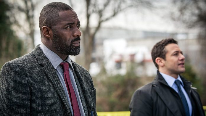 Warren Brown as DS Justin Ripley, alongside Idris Elba's Luther (c) BBC Studios