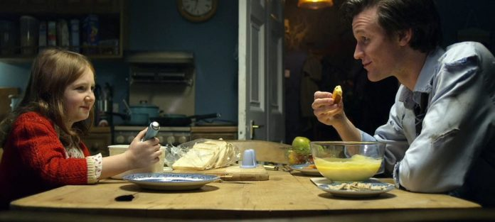 The new Doctor (Matt Smith) and Amelia Pond (Caitlin Blackwood) dig into some #FishCustard (c) BBC Studios Eleventh Doctor Amy Pond Eleventh Hour