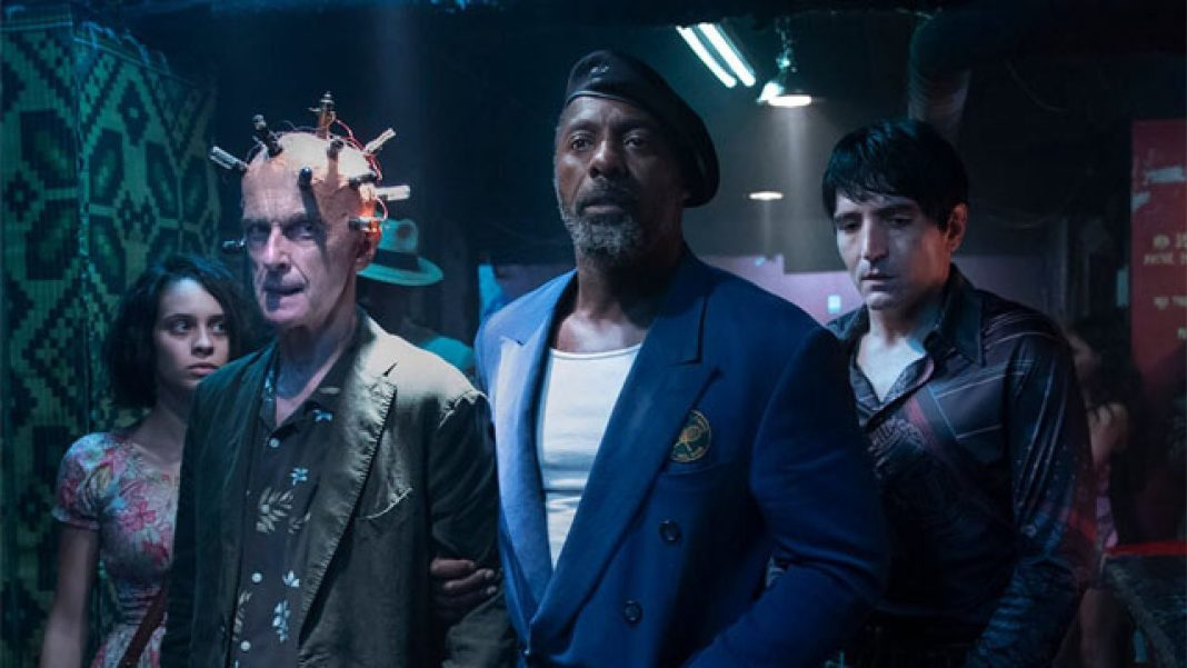 Ratcatcher (Daniela Melchior), Bloodsport (Idris Elba), and Polka-Dot Man (David Dastmalchian) go undercover to make contact with the Thinker (Peter Capaldi) (c) Warner Brothers Twelfth Doctor Doctor Who