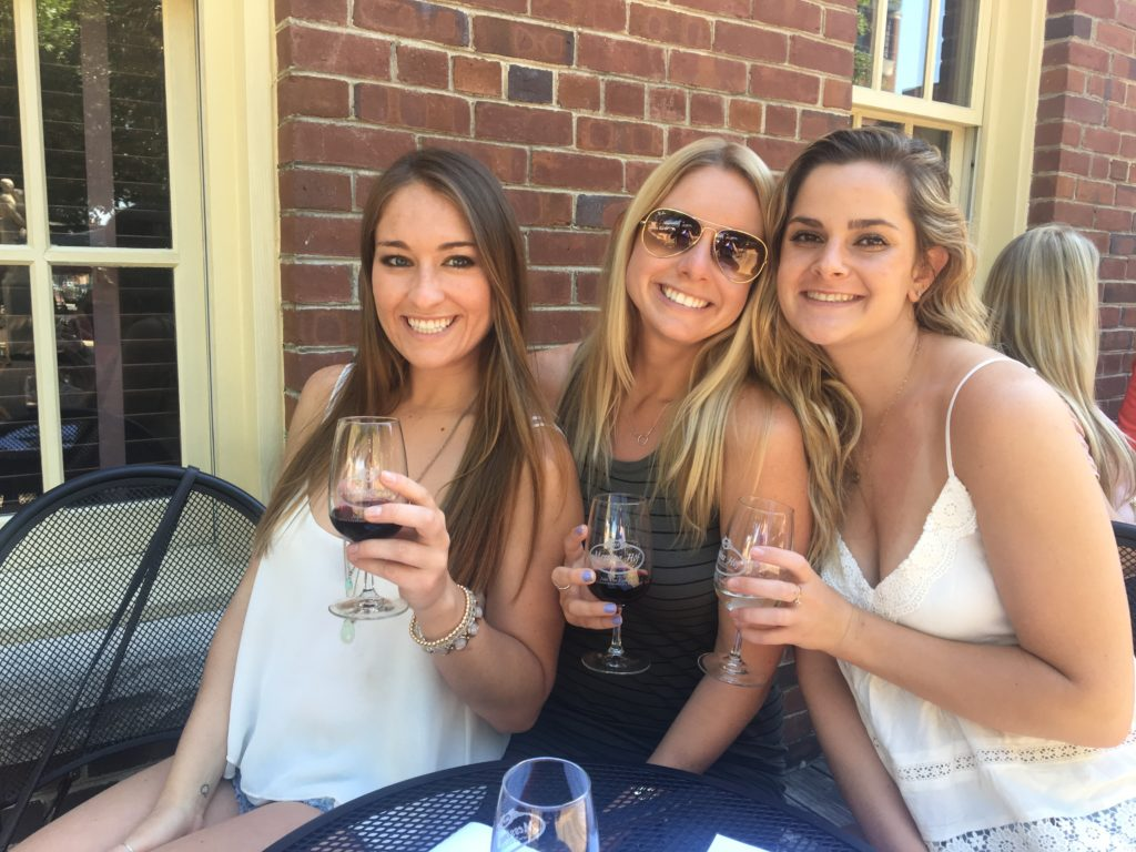 3 girls drinking wine in Dallas