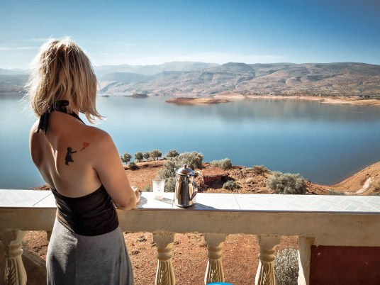 bin el ouidane lake morocco girl view mountains boat