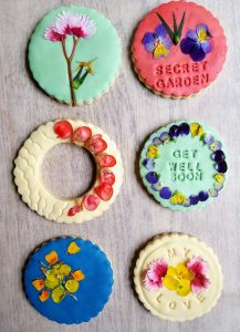 6 edible flower biscuits made by Bloom Bakers