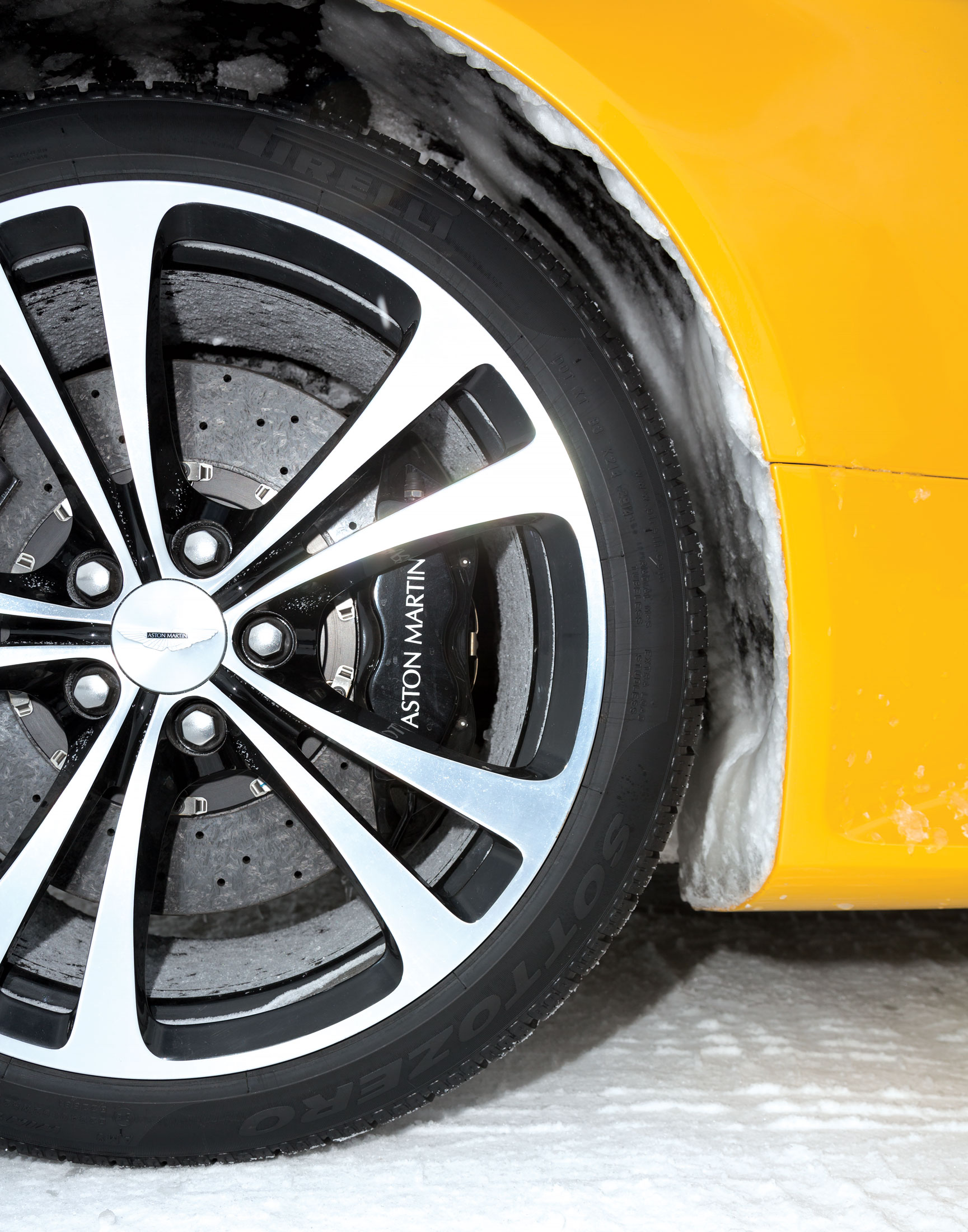 Standard snow tires on an  Aston Martin