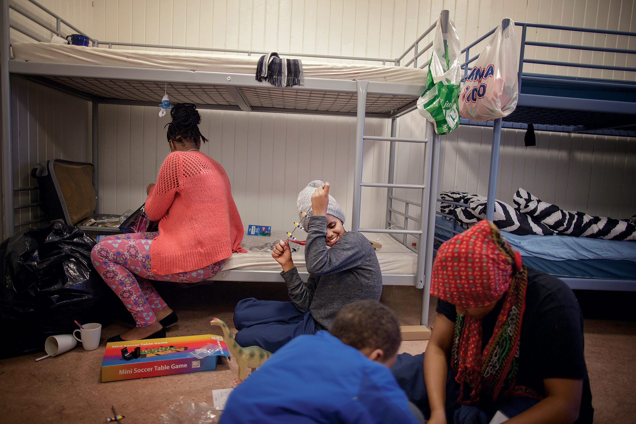 Mikal Tedros, 19, and her siblings Bethelhim, 12, Evenezer, 8, and Salina, 17, from Eritrea, in their room at the Refstad reception center in Oslo. Mikal takes care of her sisters and brother, and they have been staying at the center for a month.