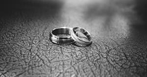 gray shot of two wedding rings