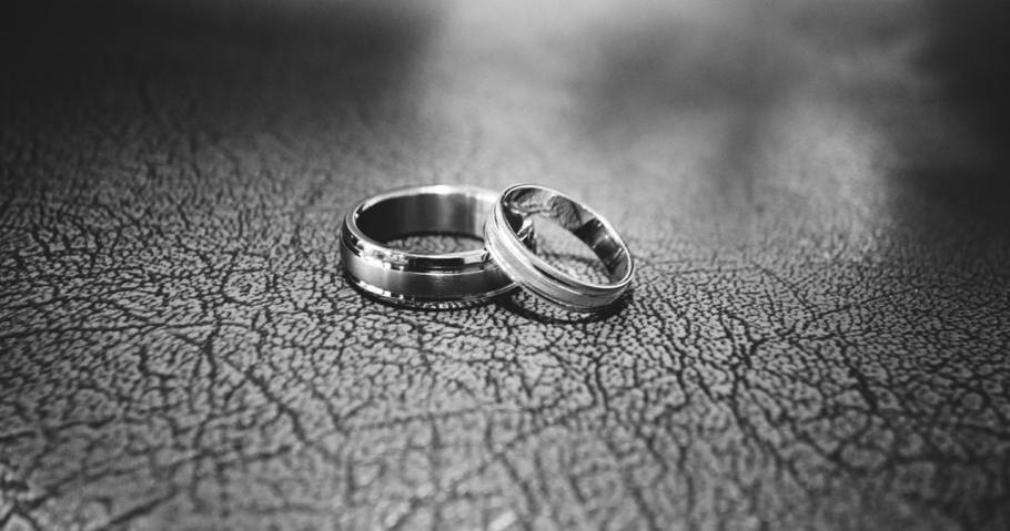 gray shot of two wedding rings