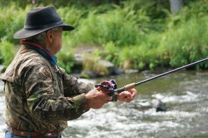 man with fly fishing hat and kit