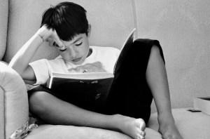 a kid reading a book