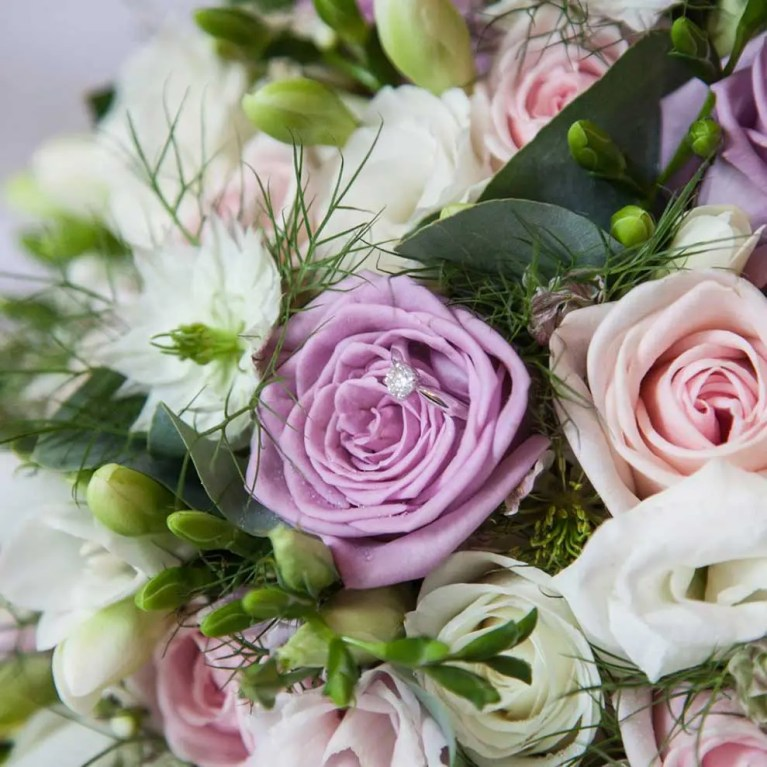 wedding bouquet with wedding ring
