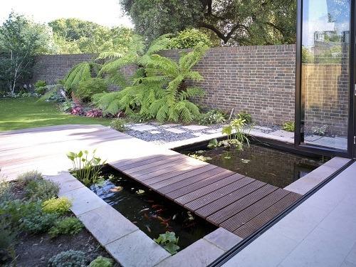 Koi carp contemporary pool with bridge