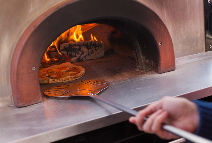 Pizza Cooking in a Stone Bake Oven