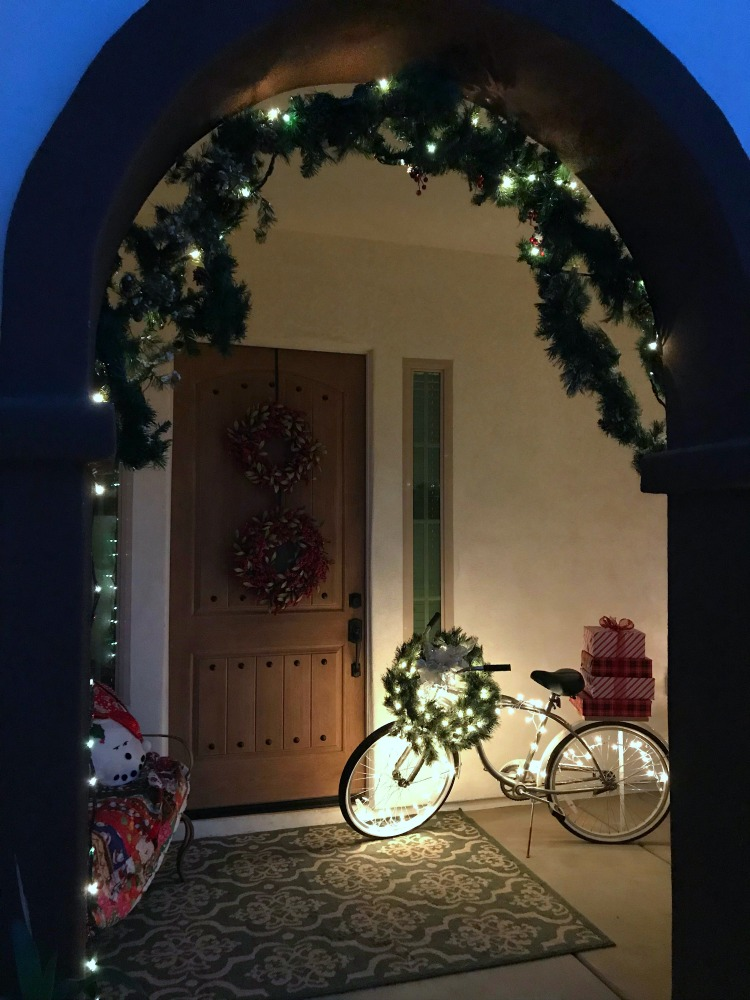 Journey to Christmas Porch Decor   blowingawayoutwest.com - Bicycle inspired Christmas porch decor. #christmasporchdecor #christmasporchdecorations #christmasbicycle #christmasporch #holidayporch #christmasdisplay #12daysofchristmas