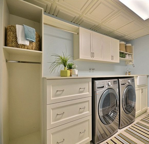 Basement laundry room with storeroom