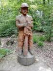 Figur eines Waldarbeiters