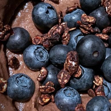 Chocolate nice cream with blueberries and chocolate granola