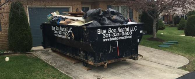 Junk in a Blue Box Rentals dumpster from the Hagerstown, MD-based dumpster rental company.