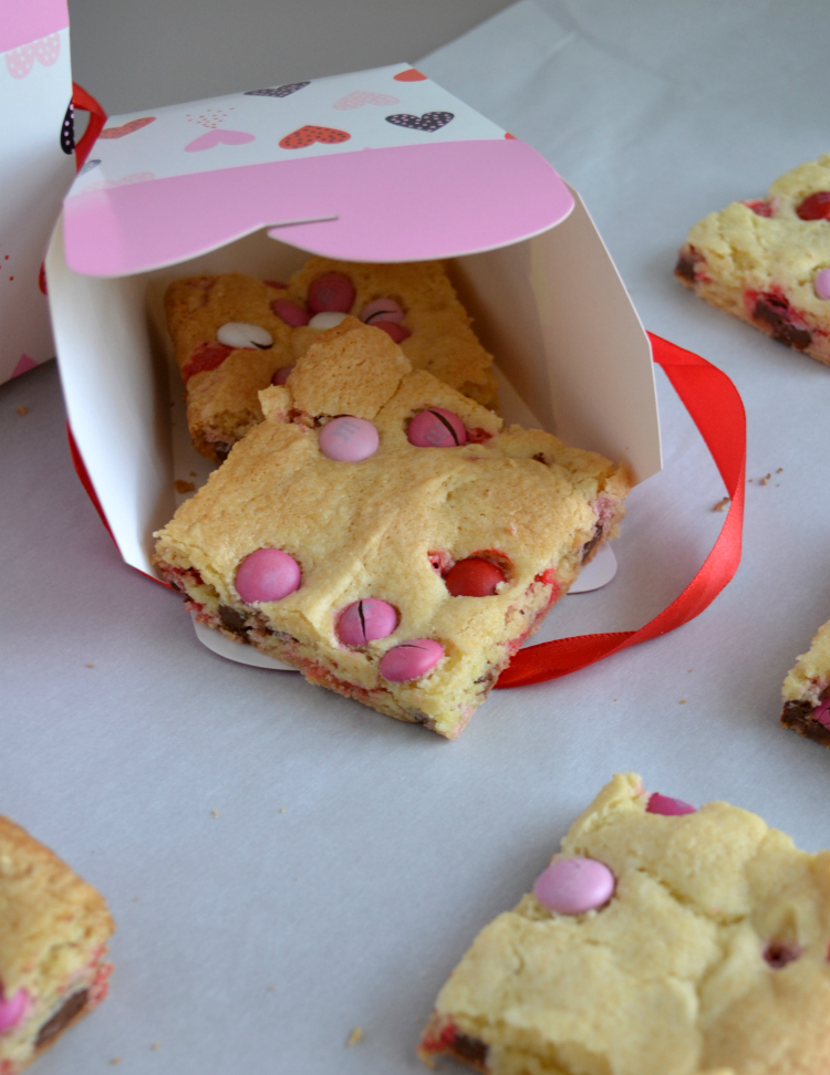 These quick and easy Cake Mix Cookie Bars with chocolate candies only require 4 ingredients but they are so buttery and rich! Cookie Bars are the perfect Valentine's Day treat for the entire family!