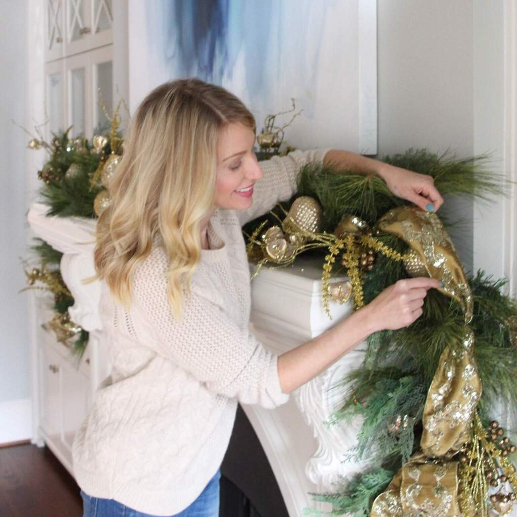 Atlanta blogger Kelly Page putting up holiday house decoration.