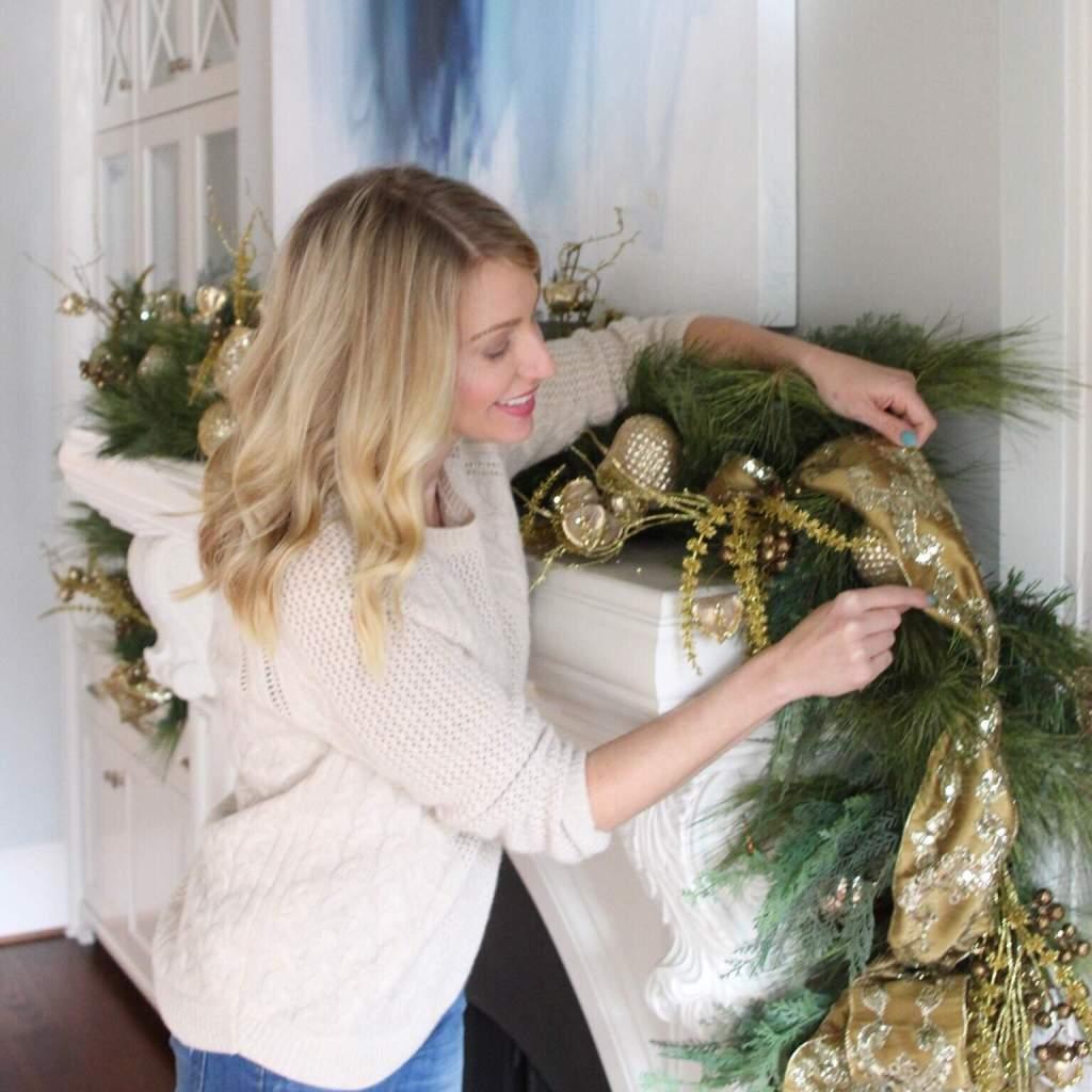 Atlanta blogger Kelly Page putting up holiday house decoration.
