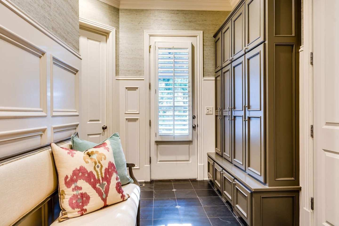 Mudroom design and mudroom built ins for easy storage for backpacks and shoes.