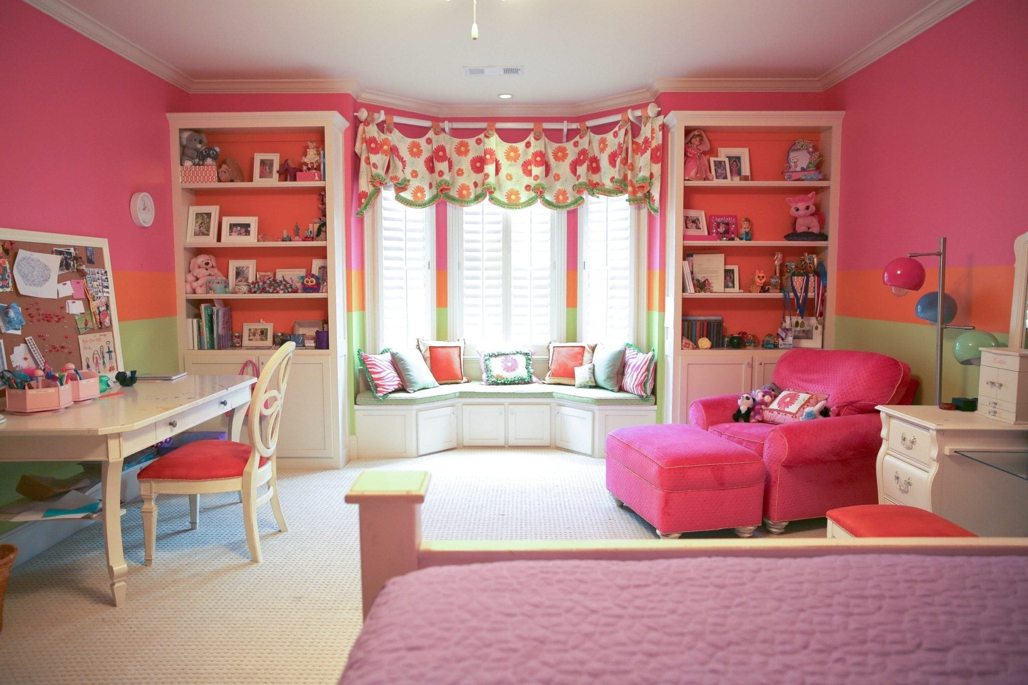 girls hot pink bedroom with flower drapery and window seat