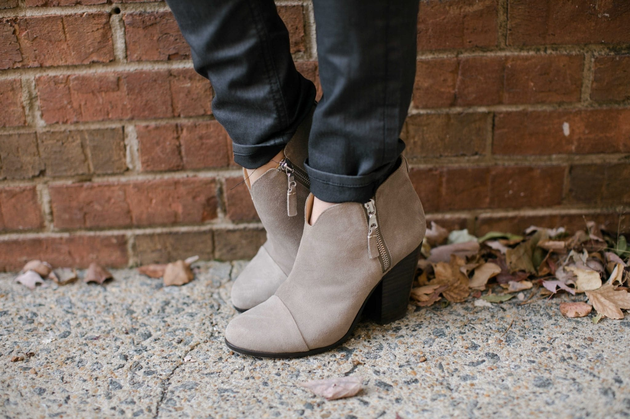 neutral suede booties with black pants and zipper side booties