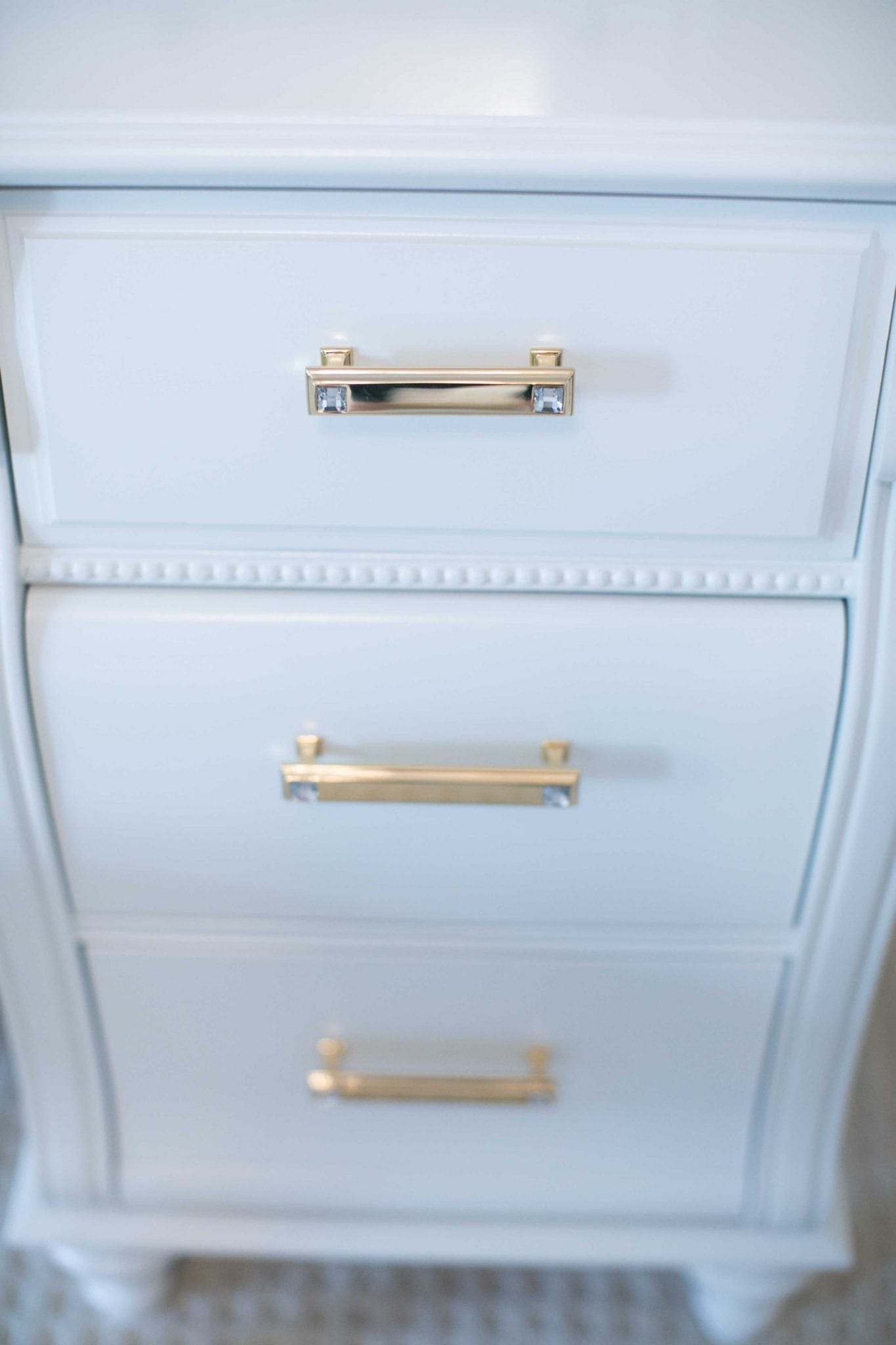modern dresser pulls with gold and a little bit of crystal in them