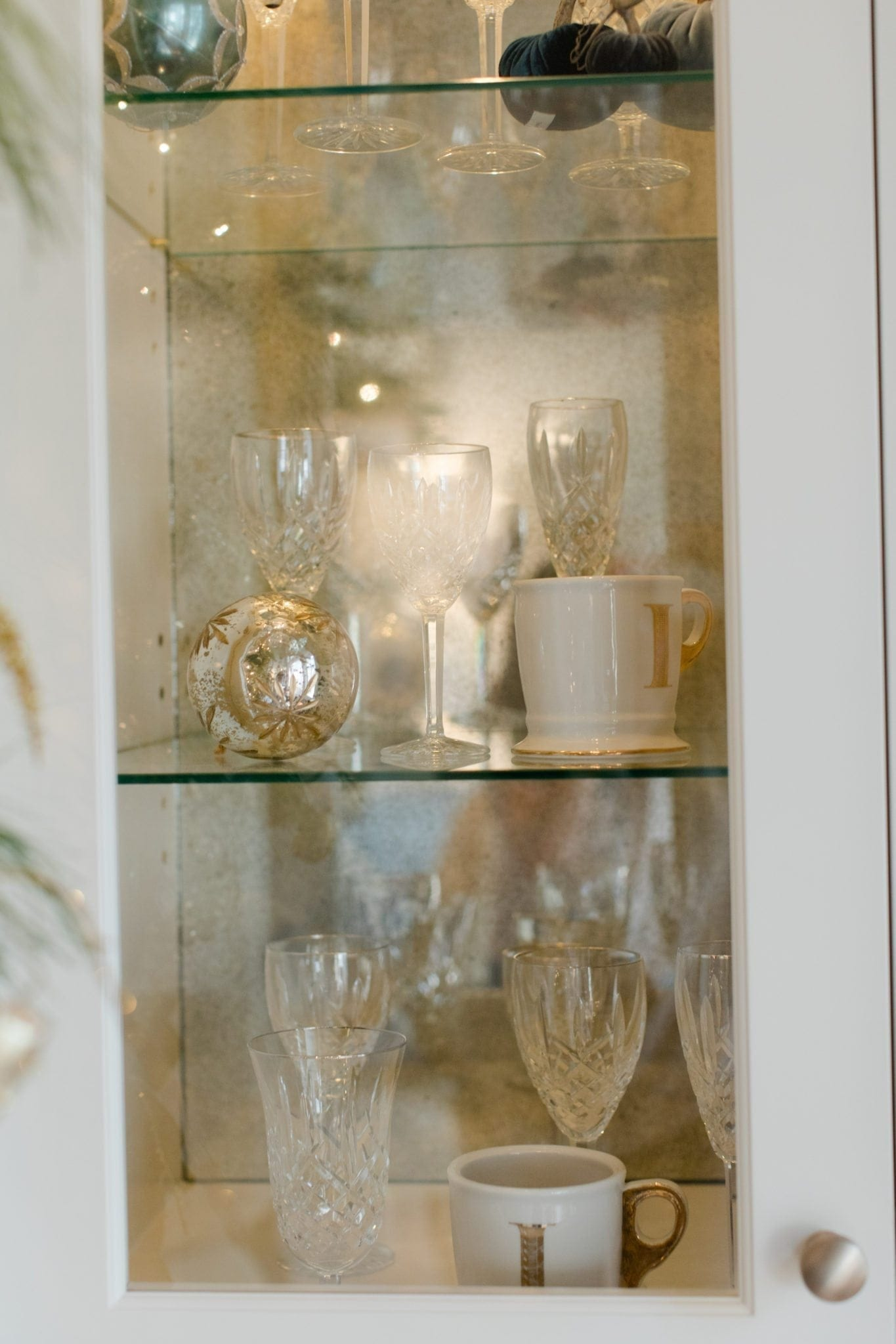 Gold and white glass with built in cabinets.